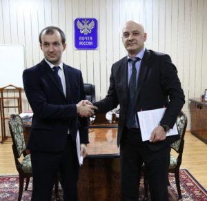 #Между Республиканским МФЦ и Почтой России подписано соглашение о сотрудничестве3